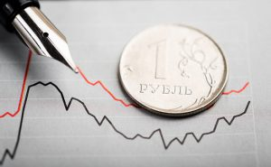 One rouble coin on fluctuating graph. Rate of the Russian rouble (shallow DOF)